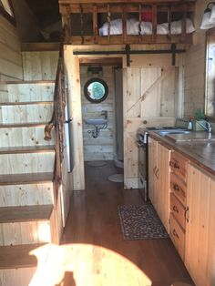 The kitchen is equipped with an 3/4 refrigerator, four burner electric stove, microwave, and sink.