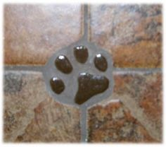 Decorative ceramic tiles of cat and dog tracts...cute.