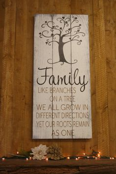 Family like branches on a tree..... This is a wood pallet sign that measures 16 x 36. The background is Ivory. Tree design and word Family is Black. Other wording is Tan.  This piece is handpainted and sanded for a distressed/vintage look. It is then sealed with a water based varnish.  The back is left unfinished and comes ready to hang.