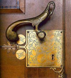 intricate door knob and lock. bronze. gold. timber. beautiful.