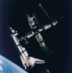December 17, 1995:      The Space Shuttle Docks with Mir   -   Credit: NASA, Russian Space Research Institute   -   Explanation: Hundreds of kilometers above the Earth's surface, the United States Space Shuttle Atlantis docks with the Russian Space Station Mir. The photograph was taken by Nikolai Budarin from a Russian Soyuz spacecraft on July 4, 1995.   More...