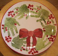 Handprint Christmas Wreath. This would be he cutest idea for Christmas dinner ware......imagine the memories year to year when you take out their little handprints for Christmas dinner.