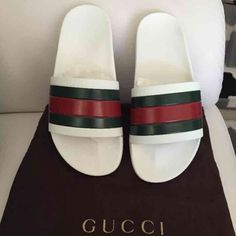 Shop Men's Gucci White Green size 6 Sandals & Flip-Flops at a discounted price at Poshmark. Description: Gucci rubber slides white -green -red brand new no box has dust bag mens sz 6 women's Sold by beststyle. Slide Sandals, Flip Flop Sandals, Bape, Gucci Shoes, Shoes Heels, Gucci Gucci, Swag, Matches Fashion, Fashion Sites