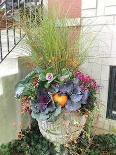 Fall Vegetable Gardening Fall Planter with kale grass and pumpkins - It's time for some inspiration for gorgeous fall planters. I have 8 spectacular ones to share, featuring kale with it's pretty scalloped, ruffled leaves. Fall Flower Pots, Fall Flowers, Colorful Flowers, Fall Planters, Flower Planters, Garden Planters, Container Flowers, Container Plants, Fall Mums