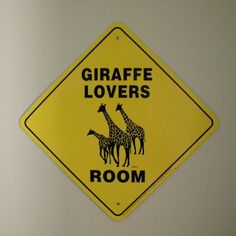 Such a True sign. I may have to get it to warn visitors of all the giraffes theyll be overwhelmed with. One day I'll get them all in one room.