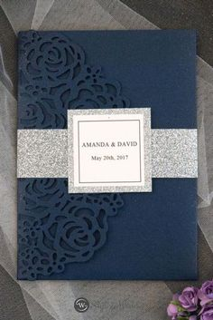 Navy blue and silver is always the perfect color combination for your elegant weddings.The rose laser cut wrap is sure to excite your guests as to what is inside.
