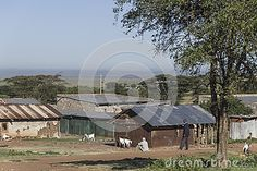 African man  and  cottages in the village,  Kenya. South Africa