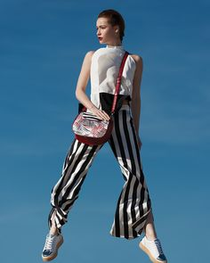 The Saltmarine Trend The classic navy stripes reinvent themselves and get inspired of digital waves and modern art silhouettes. High waist striped trousers, long cotton shirtdresses and jumpsuits combined with metallic sneakers, create the new sporty chic attitude of this trend. Add extra glam to your outfit with accessories in shades of red, blue or white, and stand out in style. #doca #ss17 #campaign #fashion #marine #nautical #stripes Nautical Stripes, Navy Stripes, Digital Wave, Metallic Sneakers, Campaign Fashion, Sporty Chic, Shades Of Red, Bold Colors, Silhouettes