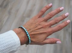 Opals are set in Sterling Silver which is typical of Victorian Jewelry. The rest of the bangle is 14 karat yellow gold