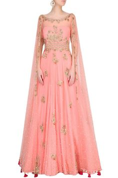 Monika Nidhii - Featuring a surreal rose color flared gown in net with scattered sequins all over and gold embroidered floral motifs along with cape sleeves and pom poms around hem. Designer Gowns, Indian Designer Wear, Indian Dresses, Indian Outfits, Salwar Kameez, Lehenga, Anarkali, Gaun Dress, Kaftan
