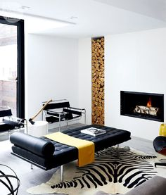 On our shopping list: a black leather lounger, a Zebra print rug and yellow extras. See more at Interiors > House Tours > Sleek and Sophisticated Home {Photo by: @graydonpictures | Styling: @chanlonprops}
