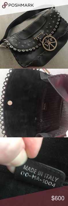 """Christian Dior black leather purse Christian Dior black leather purse. Small crystal studs and metal studs lining flap with Dior peace sign hanging. Each side of the handle has a metal """"D"""".  The main part of the bag has a leather band weaved through. Only one spot on the back of the bag. Used a handful of times. Christian Dior Bags Shoulder Bags"""