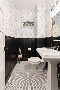 Minor changes can make a drastic difference—like this classic black and white half bath with a touch of brass and wallpaper. Black And White Theme, Black And White Tiles, Penny Tile Floors, White Bathroom Tiles, Bathroom Splashback, Black Grout, Powder Room Design, White Oak Floors, Bath Design