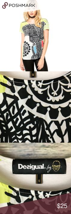 """Desigual Nousi Printed Short Sleeve Tee Super cute black, white and lime green printed tee/blouse. Has a very small hole on the back near the bottom. There is also a small discoloration at the top on the front. Please see photos.   Measurements laying flat (without stretching) - -Armpit to armpit: 18"""" -Length, shoulder to hem: 23"""" front, 24"""" back Desigual Tops Blouses"""