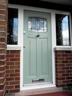 A Chartwell Green Newark with Lantern Glass and Central knob Front Door Porch, Porch Doors, House Front Door, Exterior Doors With Glass, Glass Barn Doors, Exterior Front Doors, Green Front Doors, Painted Front Doors, Front Door Colors