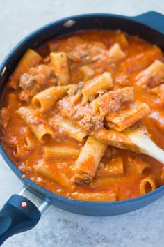 This one pot rigatoni is saucy and cheesy, and it's a better-for-you pasta option - it's a weight watchers friendly pasta! Saucy, creamy, and DELICIOUS!