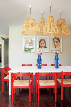 Dining Room Rattan lights by Vittorio Bonacina are juxtaposed with red chairs by Vico Magistretti. #CroscillSocial