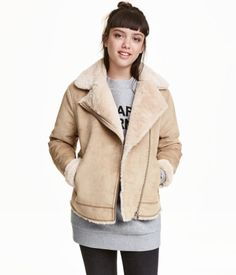 Beige. Biker jacket in imitation suede with decorative seams. Diagonal zip, notched lapels, and side pockets with zip. Faux fur lining.
