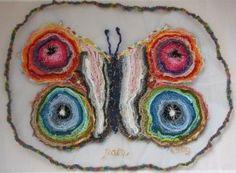 Mijn eerste vlinder, gehaakt van alle garens die ik op dat moment in huis had voor het Vredesproject.