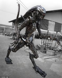 Larger than sci-fi: Metalsmiths spend up to two months making the 8ft-tall pieces including this Alien recreation and sell them for up to £5,000