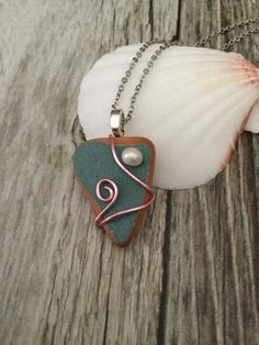 Sea Pottery / Sea Glass Necklace with Pearl by JNsArtnTreasures on Etsy https://www.etsy.com/listing/595008854/sea-pottery-sea-glass-necklace-with #wirejewelry