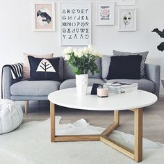 Love the grey linen sofa with the relaxed yet sophisticated coffee table with raw wood legs. -g.d