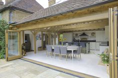 Garden room dining Too large an opening from dining to patio - you lose too much of the feel of being inside, feels too much like youre in the garden (if you wanted to be in the garden, youd just sit in the garden to eat). Orangerie Extension, Extension Veranda, Cottage Extension, House Extension Design, House Design, Building An Extension, Extension Ideas, Garden Room Extensions, House Extensions