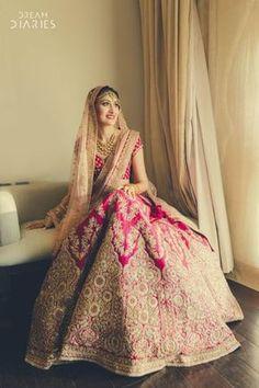 Looking for Beautiful Pink and gold bridal lehenga with light peach dupatta? Browse of latest bridal photos, lehenga & jewelry designs, decor ideas, etc. Indian Bridal Outfits, Indian Bridal Lehenga, Indian Bridal Fashion, Indian Bridal Wear, Indian Dresses, Bridal Dresses, Lehenga Wedding Bridal, Wedding Mandap, Eid Dresses