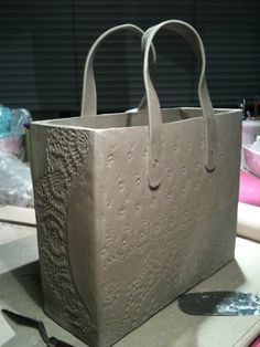 I don't love fancy bags...but maybe somebody else does. just like handbuild shoes