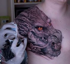 Dragon's Head with Fiery Oeage Eyes | Best tattoo ideas & designs