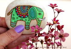 A small #paintedstone elephant and tiny flowers