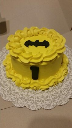 Batman smash cake by Ferris Sweets Co. Of Boise Idaho.  Www.facebook.com/ferrissweetscompany