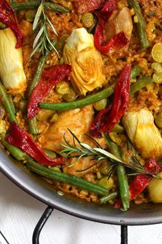 Chicken Paella Valenciana! - The Daring Gourmet All the beautiful components of traditional paella, but without the snails!