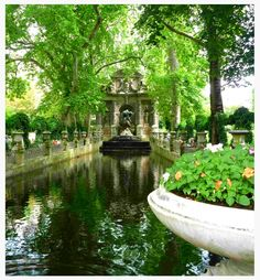 The Luxembourg Garden is known for its' lawns, flowerbeds, tree-lined promenades, the modern sailboats on its' circular basin, and for picturesque Medici Fountain, built in 1620.