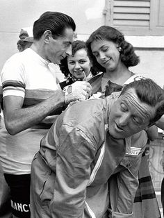 Fausto Coppi handing out autographs.