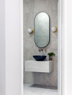Our Line Wall Light 2.0's in a powder room in Palm Beach, designed by Nina Maya Interiors. Photo - Felix Forrest