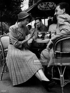 A Parisian woman wearing a mass-produced Norman Hartnell design, sits at a cafe in St Germaine des Pres, Paris. These dresses are on sale at Paris boutique Au Printemps, and are proving immensely. Get premium, high resolution news photos at Getty Images Modern Photography, Vintage Photography, Film Photography, Black And White Photography, Norman Hartnell, Pin Up, Classy People, Old Paris, Street Portrait