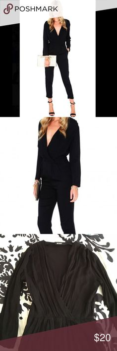 Missguided Black Trixette cross over bodysuit Black crossover jumpsuit with two side pant pockets, flattering crossover top, belt loops, hidden side zipper closure. Fabric: 95% polyester and 5% cotton. US size 6/ UK size 10 Missguided Pants Jumpsuits & Rompers