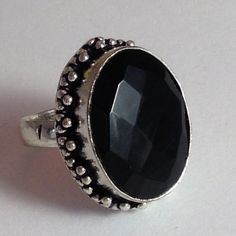 % 925 Silver 49 ct  Black Onyx ring size 7.5  Gorgeous, shiny, multi- faceted % 49 carat  Black Onyx gem stone, hand made with vintage style & ornate   % 925 Sterling silver adornments around stone and setting & band also % 925 Sterling Silver w/ 925 stamp. High quality, lovely size 7.5 ring. Face measures 7/8 X 5/8 inches  NWOT Hand made Jewelry Rings