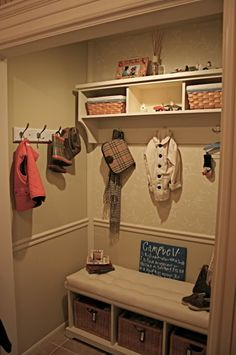 entry way or back door closet made into nook for all the stuff!