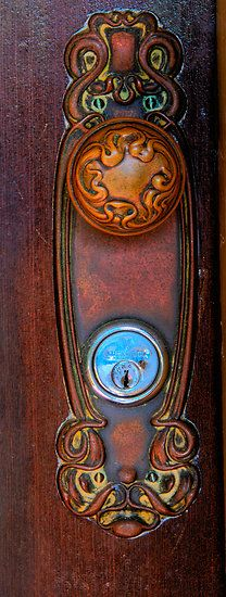 A thoughtfully crafted door handle and knob. Gorgeous.