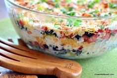 Southwestern Layered Salad - Great to make ahead for a potluck or BBQ! #recipe at Chew Nibble Nosh