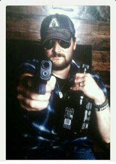 Eric Church..this bout sums it up. he is sexy as hell!!!!!!! And we have the same birthday :}