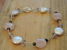 Check out this item in my Etsy shop https://www.etsy.com/au/listing/398036705/rose-quartz-freshwater-pearl-bracelet