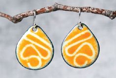 stenciled enamel earrings by Pauline Warg - from Making Enameled Jewelry: Learn Champlevé, Cloisonné, and Other Kiln and Torch Enameling Techniques - Jewelry Making Daily
