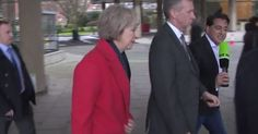 Tory refugee policy ''Hey There just a Bunch Of Migrants'' The Home Secretary slipped into her blacked out car as a reporter confronted her over David Cameron's refugee smear