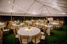 """<strong class='info-row'>Greg and Jess Photography</strong> <div class='info-row description'><html>  <head></head>  <body>    Twinkling string lights decorated the tented reception and created a romantic aesthetic.  Venue / Coordinator:   <a href=""""https://www.weddingwire.com/reviews/east-ivy-mansion-nashville/70ff37a8347ad480.html"""" target=""""_blank"""">East Ivy Mansion</a>  Rentals:   <a href=""""https://www.weddingwire.com/biz/music-city-tents-events-llc-nashville/15b08222b8310bad..."""