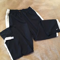 Nike Athletic Pants Nike pants. 2 pockets. Elastic waist with drawstring. On the bottom of the leg there is a 5 inch slit. White stripe down the side of each leg gives a slimming effect. Very soft and comfortable!! Gently worn. Would keep but they don't fit anymore!  Nike Pants Track Pants & Joggers