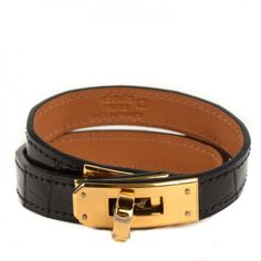 This is an authenticHERMES Shiny Alligator Kelly Double Tour Bracelet, size Small in Noir Black. This ultra-chic bracelet is crafted of a surface of shiny blackalligator leather.