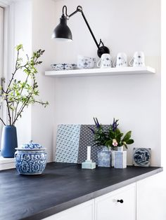 Playing with patterns in a blue and grey kitchen. A little farmhouse warmth for a modern Scandinavian kitchen.